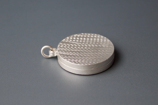 stylish locket for two pictures with grass design in sterling silver