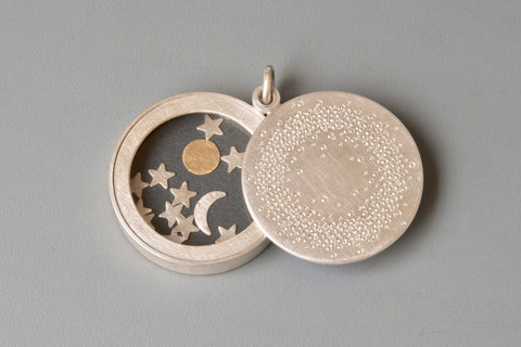 unique sterling silver glass locket filled with sun moon and stars
