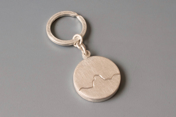 silver keychain locket for one photo with mountain range design