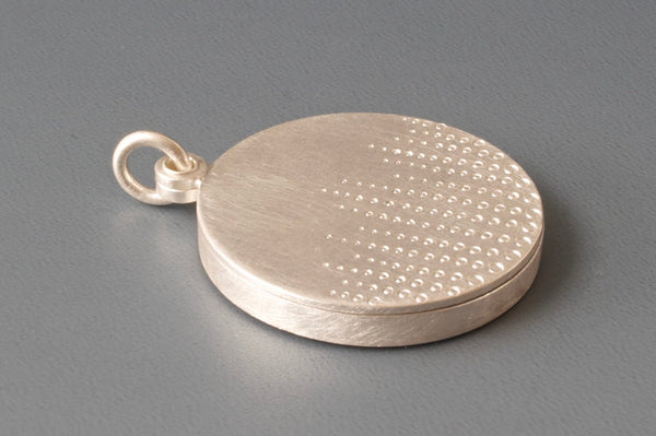 round sterling silver photo locket with drops of dew design