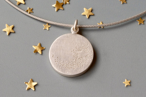 unique picture locket with a shooting star in sterling silver