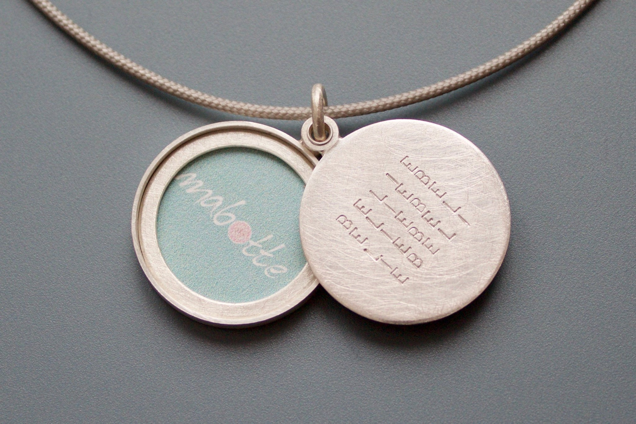 personalized love locket in sterling silver handmade in sterling silver