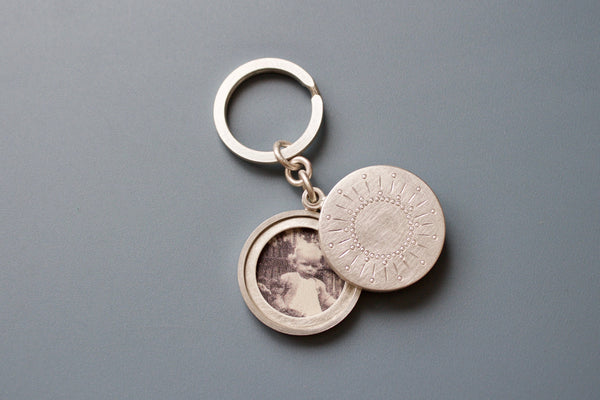 sterling silver keychain locket for two pictures  with sun decor