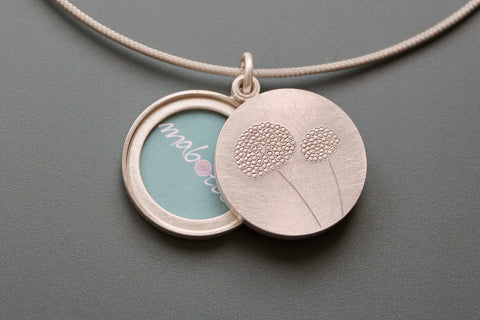 mabotte double locket with delicate dandelions in sterling silver