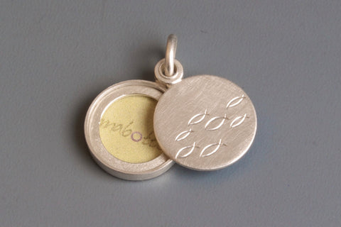 small sterling silver locket for one photo with school of fish