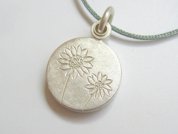 small silver mabotte locket for one picture with sunflowers