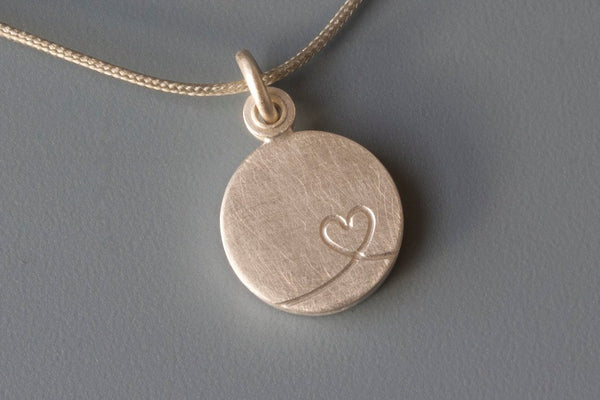 charming silver photo locket with  little heart design