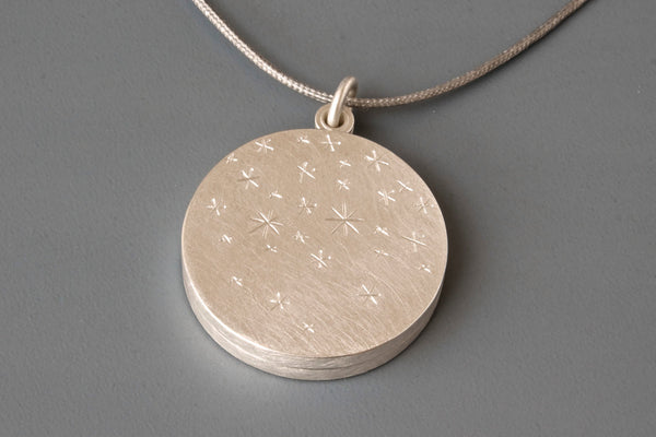 modern sterling silver locket for two photos with stars