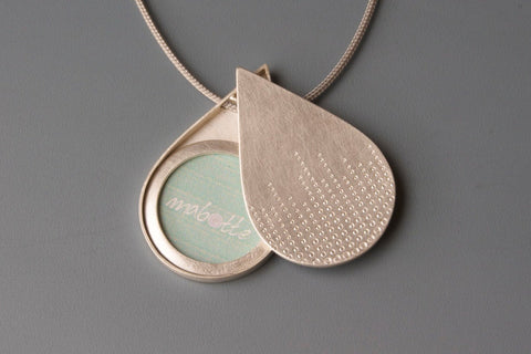 unique drop shaped photo pendant in sterling silver with drops of dew design