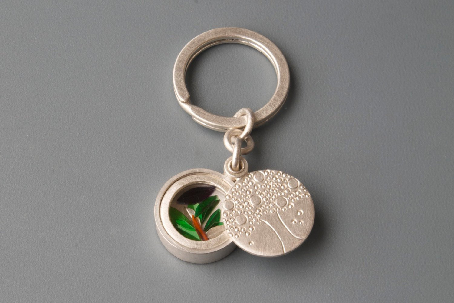 silver keyring glass locket filled with colourful leafs and tree of life