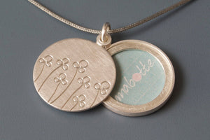 floral picture locket in sterling silver with field of flowers