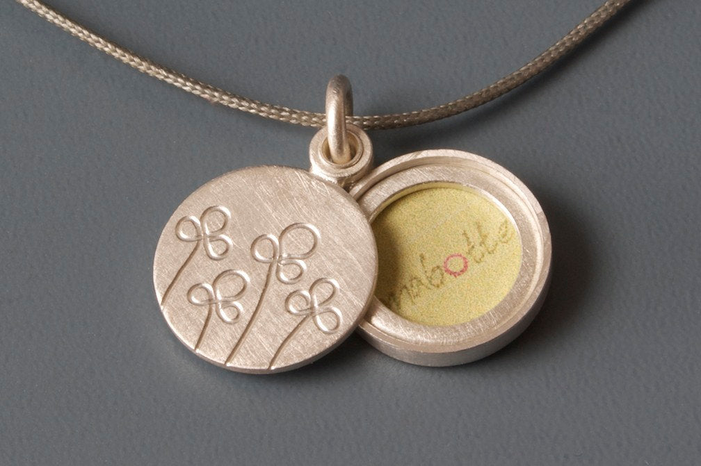 floral silver locket for a small photo with field of flowers design