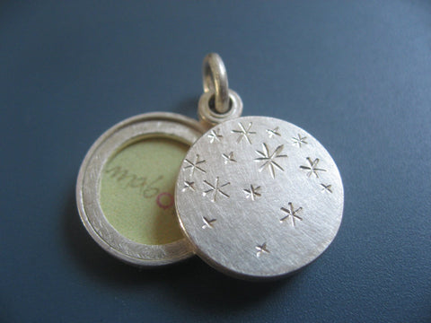 small double sided photo locket with starry night design in sterling silver