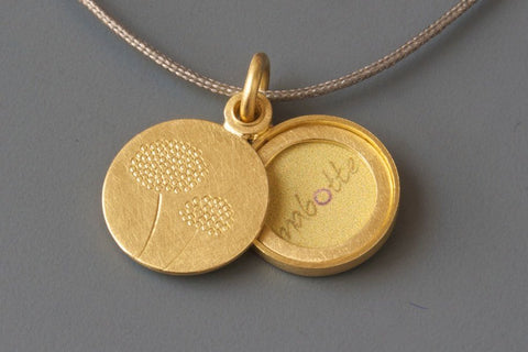 elegant and small gold locket for one photo with dandelion design