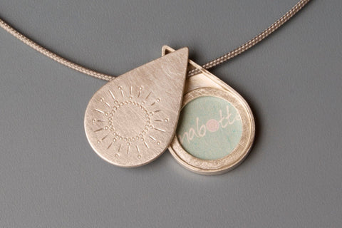 sterling silver dropshaped photo locket sun design