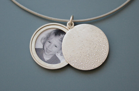 modern photo locket in sterling silver with bubbles design