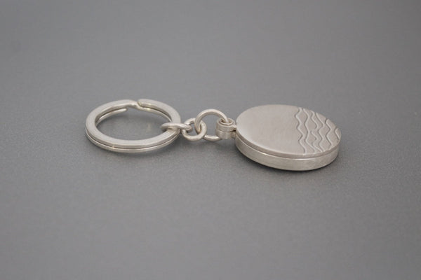 minimalist silver keychain locket with waves for one photo