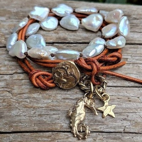 Pearl leather wrap bracelet with seahorse and star, ocean theme, by Aurora Creative Jewellery