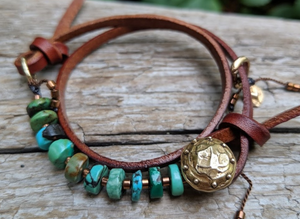 This fun handmade artisan boho leather wrap bracelet showcases the beauty of natural textures. The vibrant natural turquoise gives a pop of color on the background of natural leather.  The bracelet is finished off with a gold bronze button and leather loop. A heart charm adds another touch of gold and an element of fun. The heart charm can freely move around the bracelet so you can enjoy it from all sides.