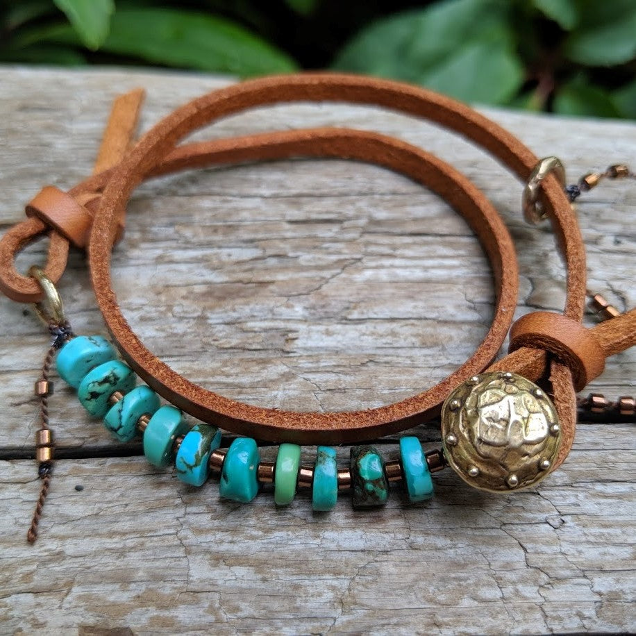 Turquoise leather wrap bracelet with heart charm and button by Aurora Creative Jewellery