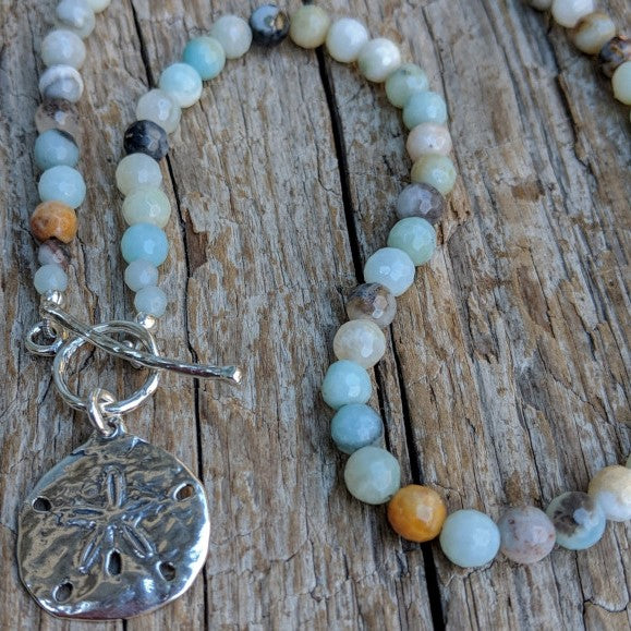 Light blue amazonite stone necklace with silver sand dollar and toggle, by Aurora Creative Jewellery
