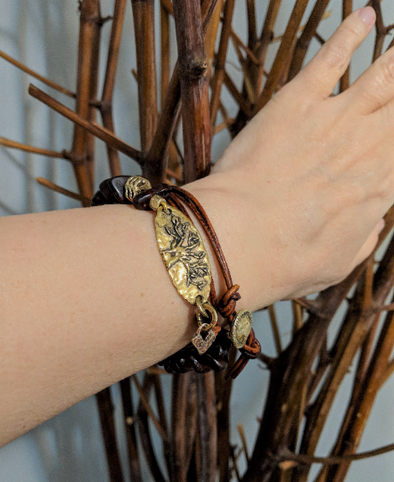 Cognac brown Baltic amber and leather wrap bracelet with gold bronze tree linker and tiny heart charm by Aurora Creative Jewellery