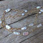 Long thin baroque pearl & gold chain necklace by Aurora Creative Jewellery