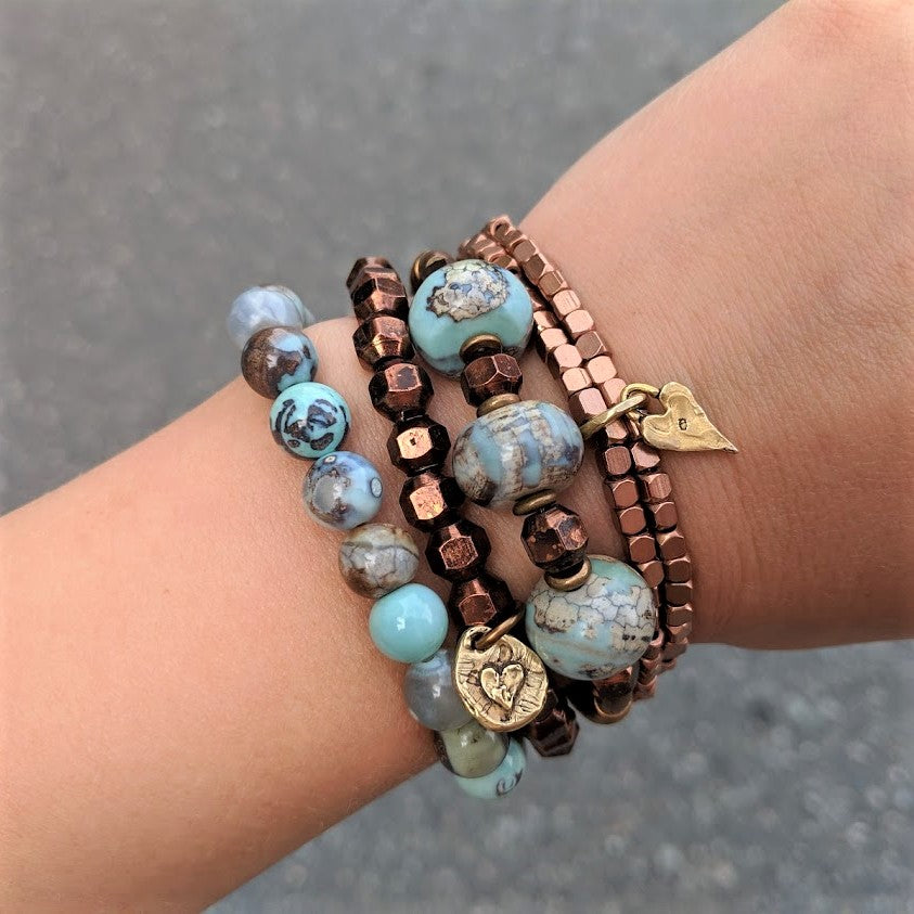 Faceted antique copper stacking geometric bracelet with artisan gold bronze heart charm by Aurora Creative Jewellery