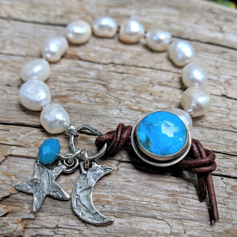 Turquoise and pearl bracelet with crescent moon, star and Swarovski crystal charms, by Aurora Creative Jewellery