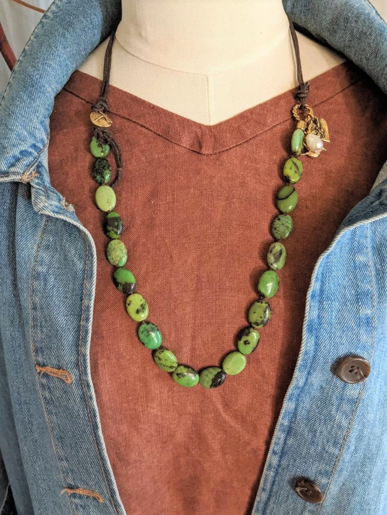 Handmade artisan chrysoprase gemstone necklace with bird and butterfly heart charms by Aurora Creative Jewellery