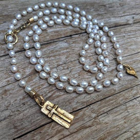 Handmade long rustic natural white fresh water pearl cross pendant necklace by Aurora Creative Jewellery