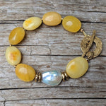 Handmade egg yolk amber and white baroque pearl bracelet with gold bronze toggle by Aurora Creative Jewellery