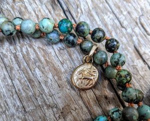 Handmade artisan African turquoise and leather rustic boho pendant necklace by Aurora Creative Jewellery