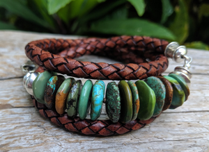 This handmade artisan turquoise and leather wrap bracelet is a chic and bright accessory that makes a statement. The beautiful rich earth colors of turquoise are complimented by brown leather and sterling silver elements. The leather is thick, but feels soft to the touch and is comfortable to wear. Wearing this bracelet feels like taking a nature walk in the forest and absorbing the beauty of natural organic colors and textures.