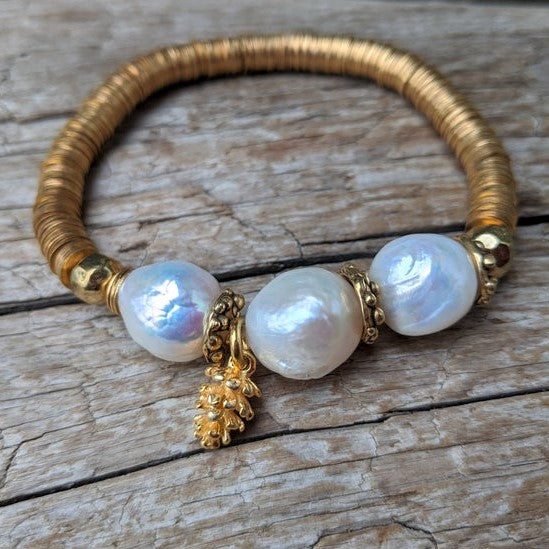 Three large white pearls elastic bracelet with pine cone charm and gold African brass by Aurora Creative Jewellery