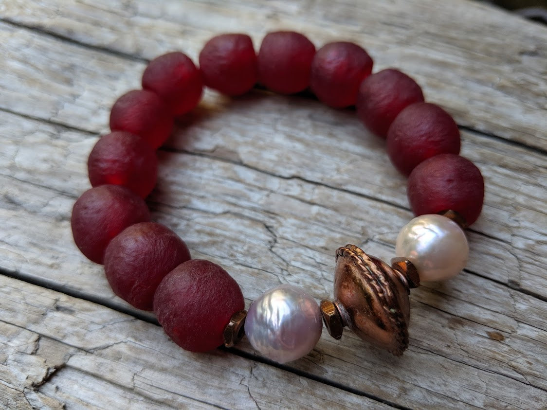 Burgundy recycled glass elastic bracelet with soft pink Edison pearls. Beautiful to wear on its own or in a stack! By Aurora Creative Jewellery