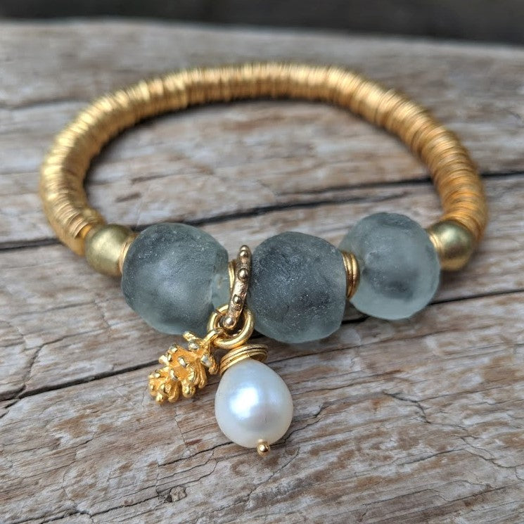 Handmade gray blue recycled glass bracelet with gold pine cone charm and white baroque pearl by Aurora Creative Jewellery