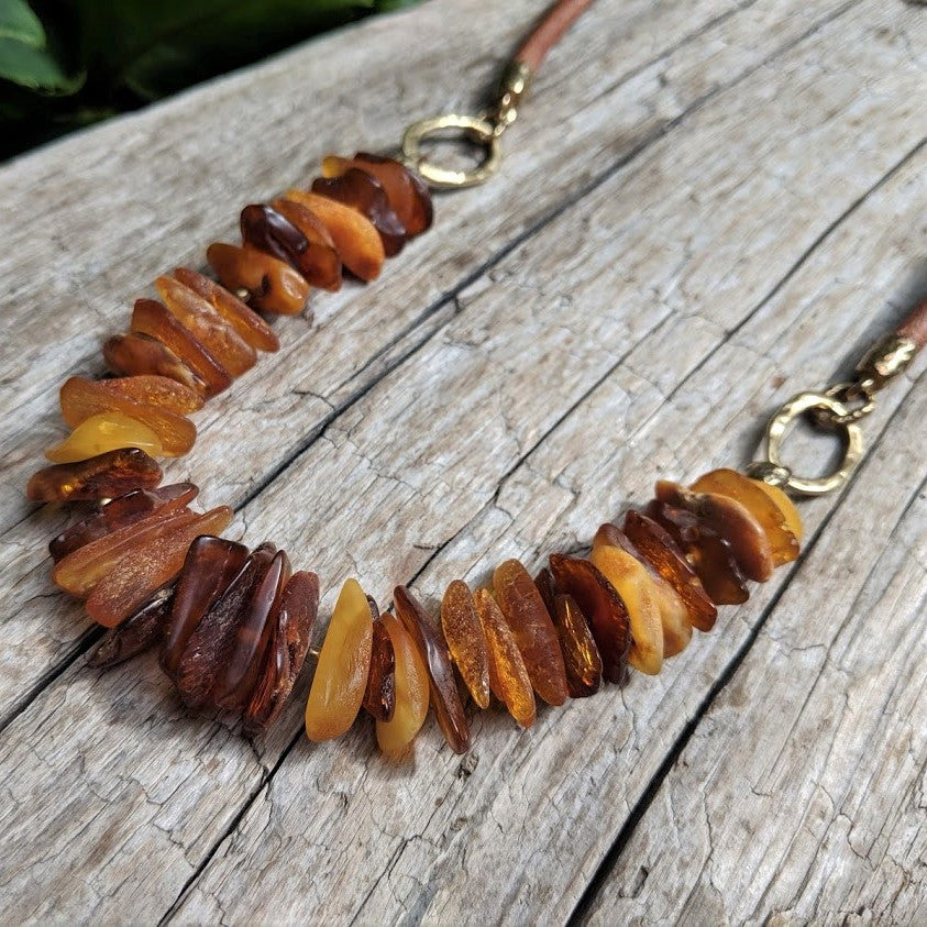 Handmade raw Baltic amber chip and leather necklace by Aurora Creative Jewellery