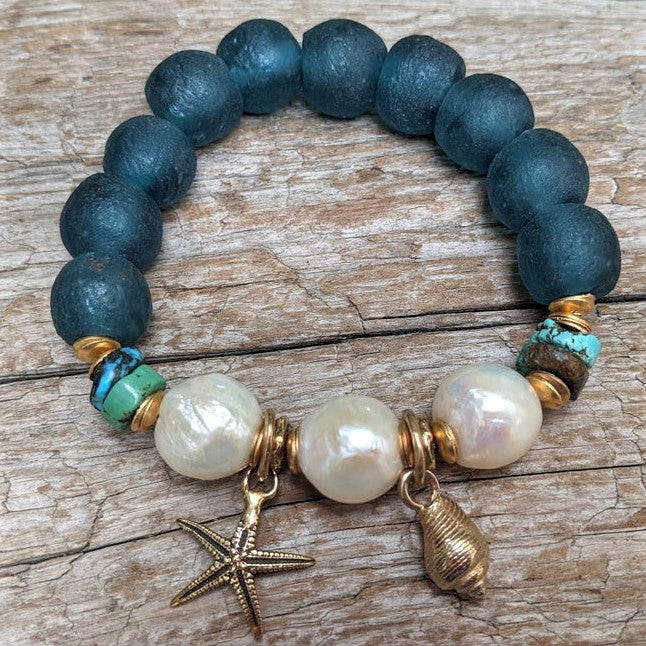 Handmade genuine turquoise, Edison pearl & recycled glass elastic bracelet with artisan gold bronze ocean charms designed by Aurora Creative Jewellery