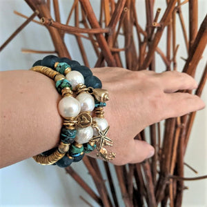 Handmade genuine turquoise, Edison pearl & recycled glass elastic bracelet with artisan gold bronze seahorse charm designed by Aurora Creative Jewellery