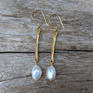 Long thin rustic baroque pearl and gold bronze bar earrings by Aurora Creative Jewellery