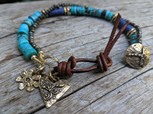 Tibetan turquoise, lapis lazuli, and pyrite bracelet with flower & heart charms, dragonfly button and leather, by Aurora Creative Jewellery