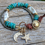 Turquoise bracelet with pearl, pyrite and gold bronze crescent moon and star charms and button, by Aurora Creative Jewellery