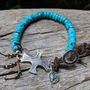 Tibetan turquoise bracelet with silver spanish cross, heart charm, pyrite, leather and button, by Aurora Creative Jewellery