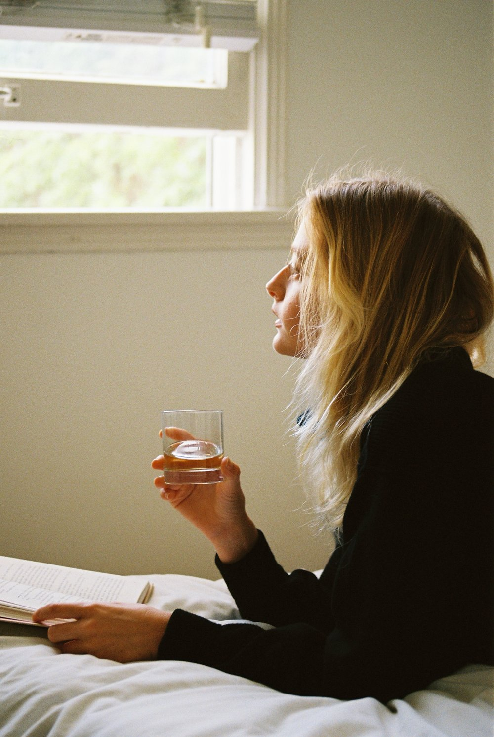 woman drinking Los Sundays tequila