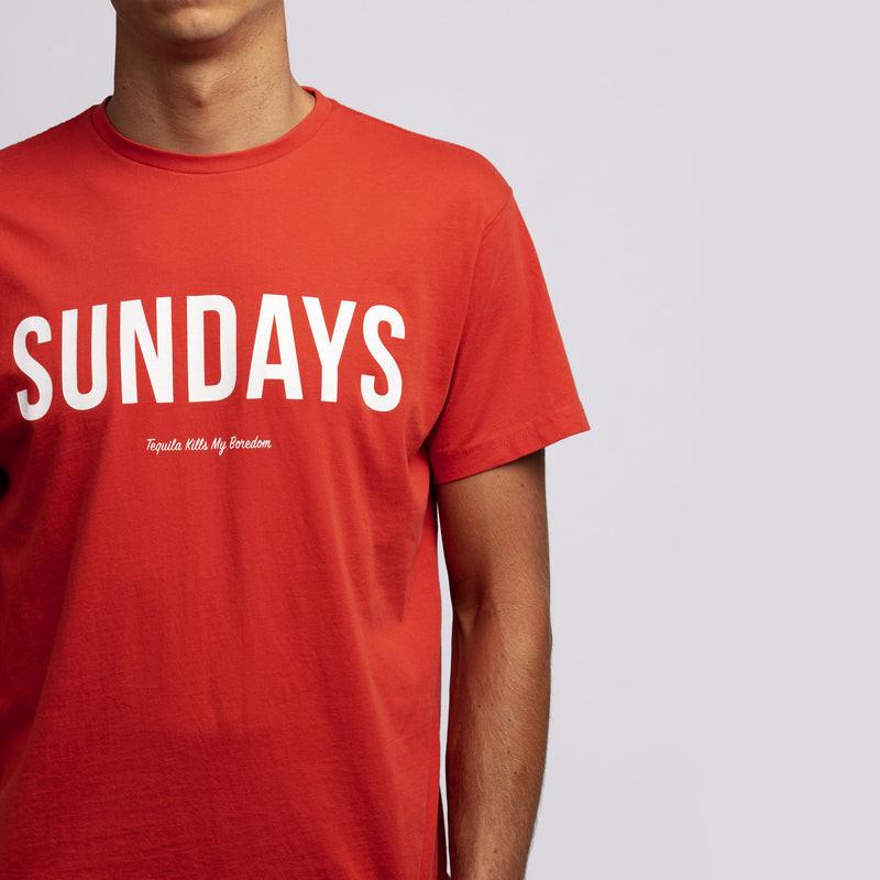 man wearing Los Sundays tee red