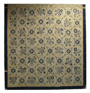 A fine and rare example of an embroidered indigo and ivory colored wool bed cover from the early nineteenth century.