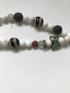 Trade beads with beads of ceramic and glass and a Tibetan child's silver bracelet