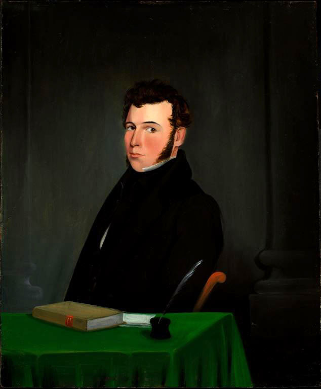 Oil on panel portrait of a man, seated at a table which holds a book, paper, and inkwell and his quill pen.