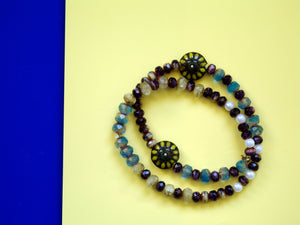 Purple double strand beaded bracelet
